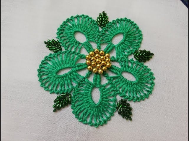 Hand embroidery:flower embroidery with beads.