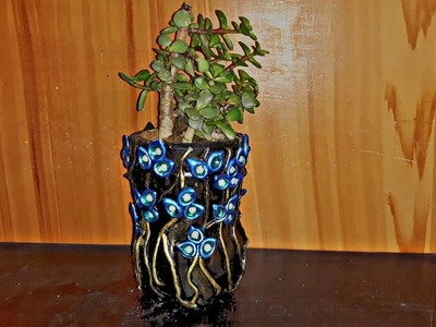 How to make a cement pot using an old plastic bottle.