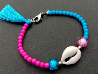 Making jewelries. out of cowrie shell. How to make. cowrie shell bracelet easily