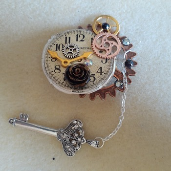 Abstract brooch with key