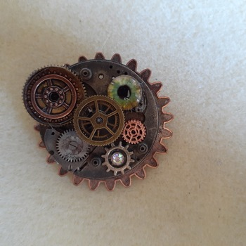 Abstract steampunk dragon eye brooch