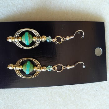 Green framed saucer bead earrings