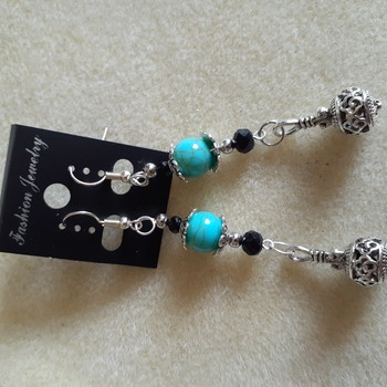 Long dangling blue and silvery beaded earrings