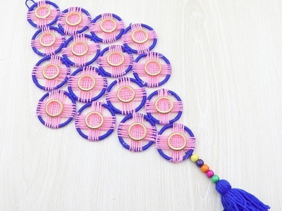 DIY WOOLEN AND BANGELS WALL HANGING TORAN.BEST OUT OF WASTE BANGELS AND WOOL CRAFT IDEA