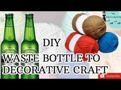 DIY decorative item out of waste bottle and wollen thread.beer bottle crafts.best out of waste