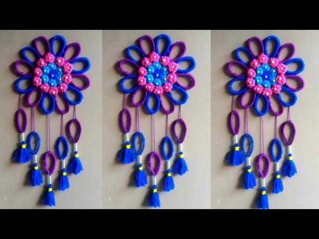 DIY easy woolen and newspaper wall hanging idea   woolen and toran craft   Room decor Ideas