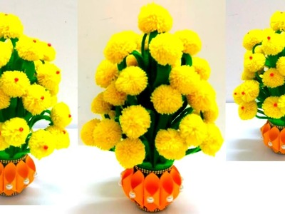 MAKE PLASTIC BOTTLE AND WOOLEN FLOWER POT.HOW TO MAKE YARN FLOWERS.VASE OF X-RAY PAPER.WOOL