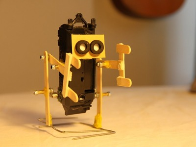 How to make a walking robot with moving arms #1 Ice cream stick biped