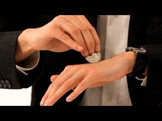 How to Pass a Coin through the Hand   Coin Tricks