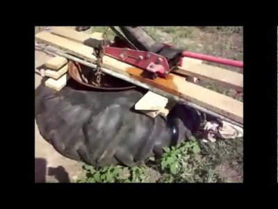 How to Break A Tractor tire Down with A floor jack and Chains