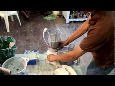 Expert making a small batch of paperclay. paper clay in a kitchen food blender