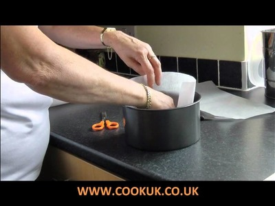 How to line a cake tin with non-stick baking paper.