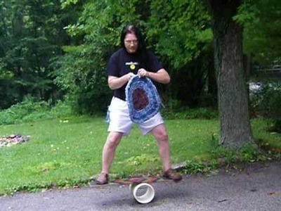 Stitching a toothbrush rug while balancing on a bongo board
