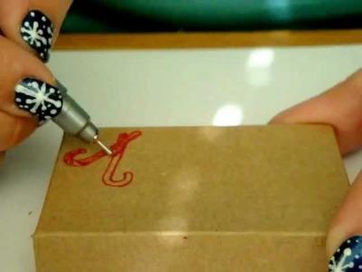 Soft spoken asmr drawing Christmas decorations on kraft boxes