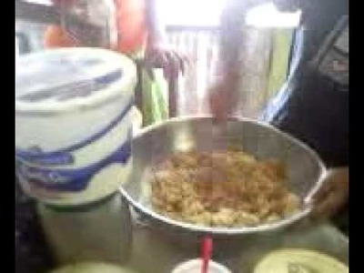 Learning to make sweet potato pudding by my cousin from St.Elizabeth