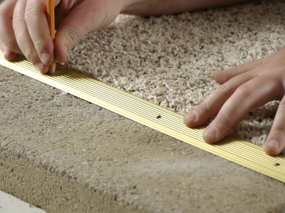 How to Install Carpet Transition Trim Between Concrete & Carpet Flooring : Carpeting Tips