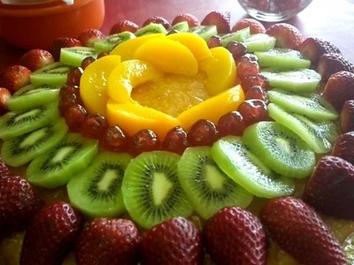 Decorating a cake with Fruit