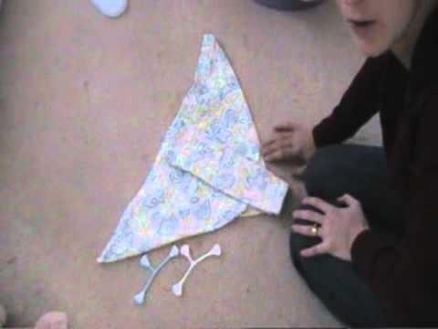 Folding a flat nappy.diaper