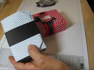 One box with one sheet of 12x12 designer paper