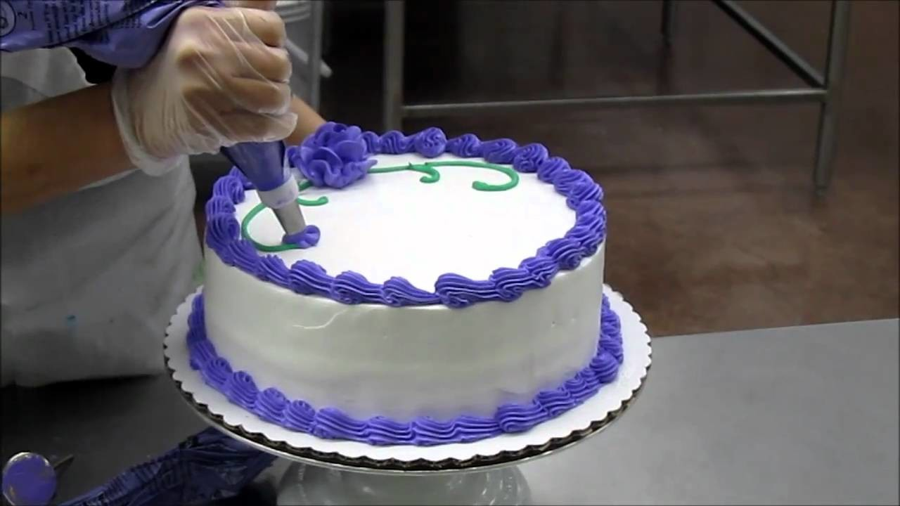 Lady Making a Birthday Cake