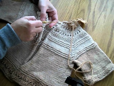 Sewing a button on a Knitted sweater