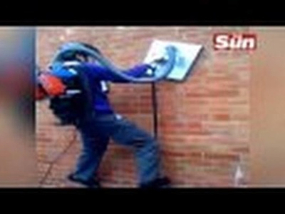 Black Russian Kid Climbing wall Doesn't Fear Death with homemade gadget like Spiderman.