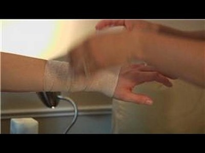 Wrapping & Taping Injuries : How to Wrap a Wrist With Athletic Tape