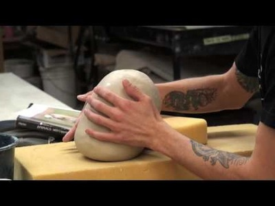 Joey Chiarello demonstrates sculpting an animal from a hollow tube