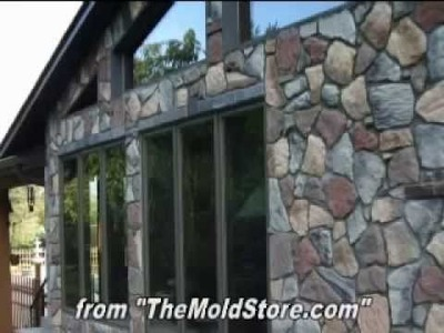 Home-Made Fieldstone Stone Veneer as Home Siding over a Wood House