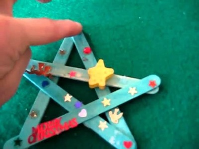 Christmas. Arts and Crafts activity: colored Popsicle sticks and stickers star decorations.