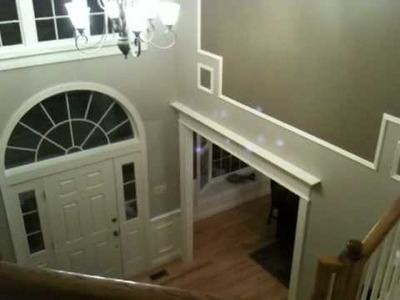 Wall Art in foyer with Decorative Doorways by CarpentryMasters.co