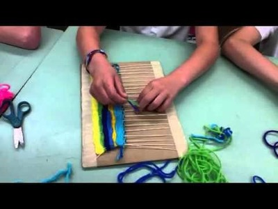 Cardboard looms and weaving for elementary art students.
