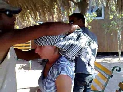 Putting on a bedouin head scarf