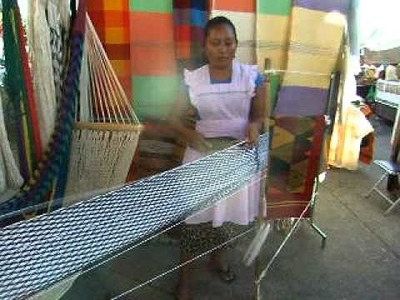 We stop a a market down town and she is making a hammock. she could make this with her eyes closed