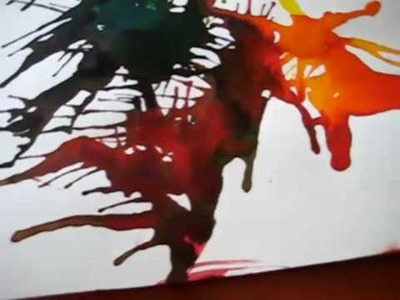 Arts & Crafts activity: colorful pictures.patterns from blowing and spreading paint through straws.