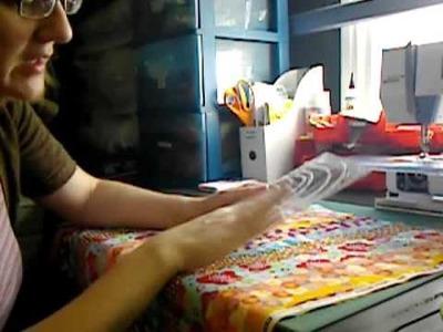 Folding fabric to a uniform size and shape