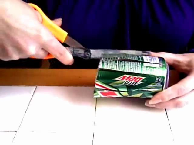 How to make a soda can candle holder.wmv