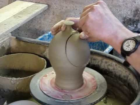 Making a clay Pottery Ceramic Salt Jar. Salt Pig on a potters wheel throwing demo
