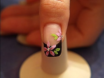 Flower design with nail lacquer and strass stones