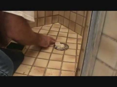 "How to grout tile: Sponging off a grout ""patch"" residue from a tile surface"