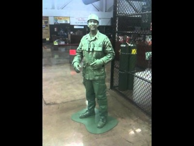 The best home made Green Toy Soldier creative costume wins the first prize at Frys Electronics