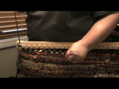 How to remove a finished twined rug from a peg loom.