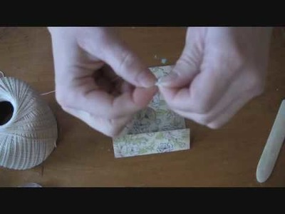 Matchbook Flap Pocket Window for Scrapbooking using an eyelet and string