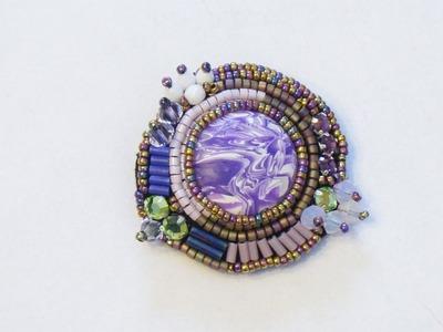Sarubbest - Spilla embroidery con perline, cabochon, bicono e bugle (Tecnica Embroidery)