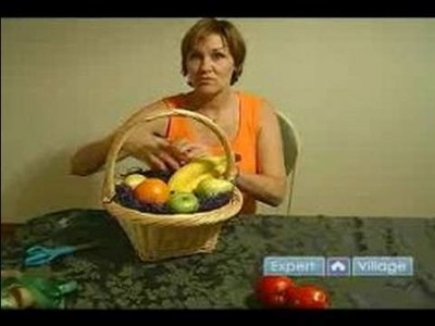 How to Wrap a Gift : How to Gift Wrap a Fruit Basket