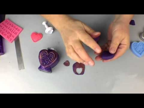 Covering a glass bottle with polymer clay to create a Bottle of Hope