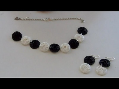 Necklace made with recycled black and white filters Dolce Gusto Capsules) Collar hecho con filt