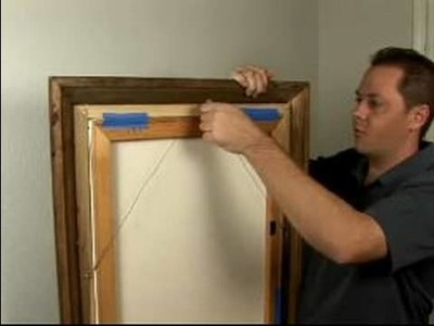 How to Hang a Picture : How to Hang Pictures with a Wire Hanger