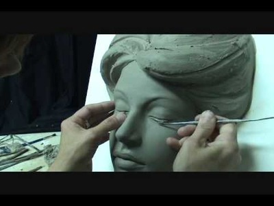 Sculpting a face in clay. Sculpting demo how to sculpt girl's face.