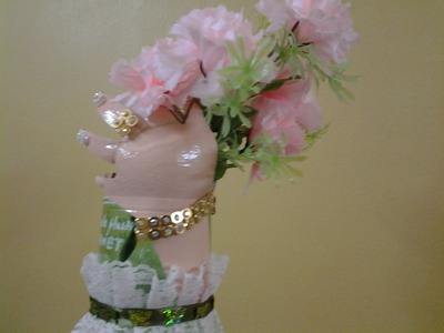 Best Out of waste Plastic bottle transformed to vase with hands carrying flowers